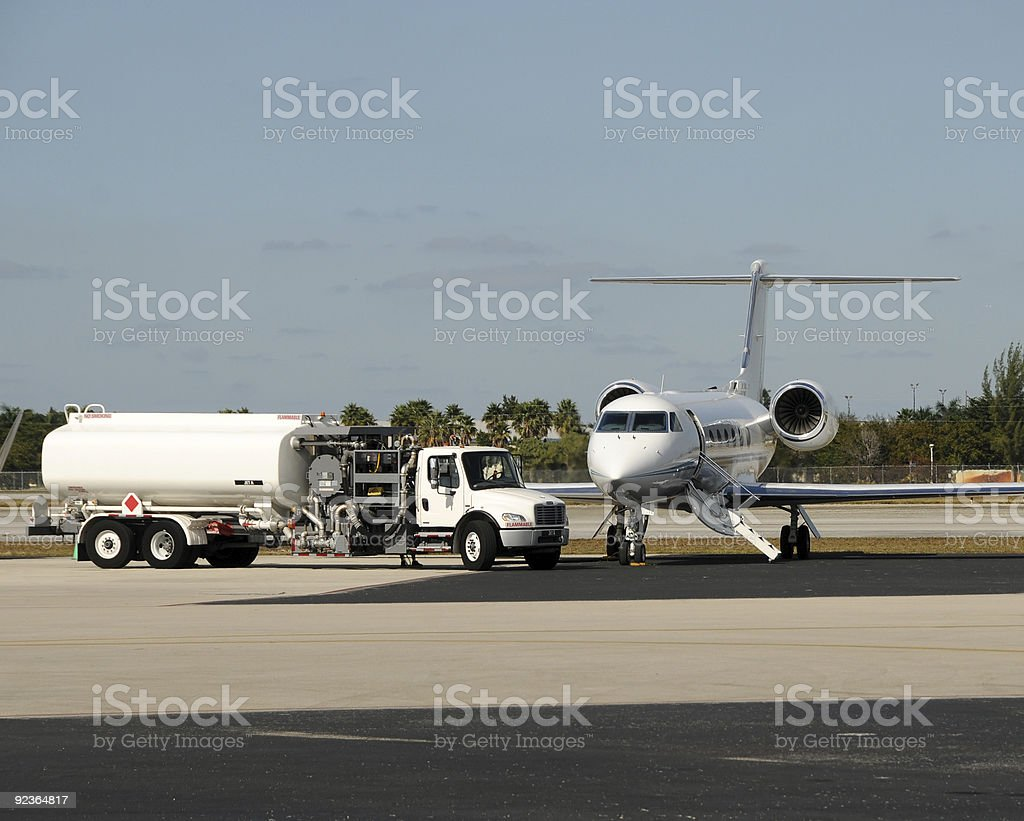 A jet airplane still on the ground stock photo
