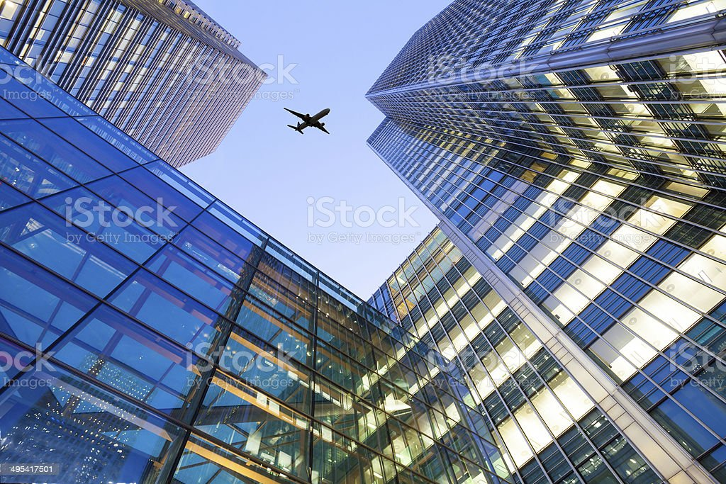 Jet airplane take off Office building, London City, England, UK stock photo