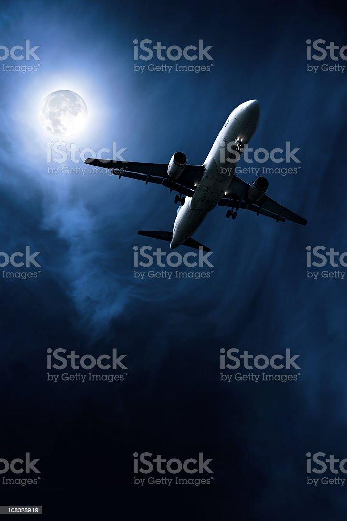 jet airplane taking off at night stock photo