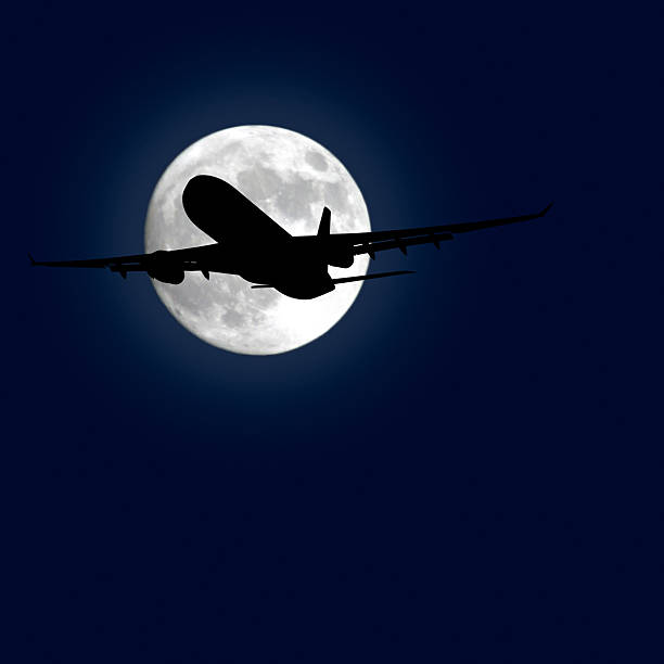 jet airplane taking off at night stock photo