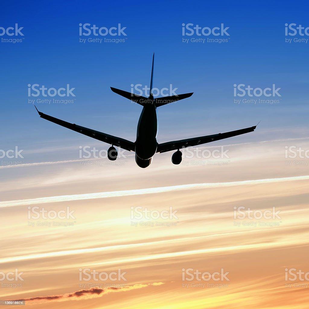 XL jet airplane taking off at sunset royalty-free stock photo