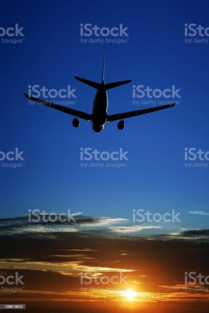 XXL jet airplane taking off at sunset royalty-free stock photo