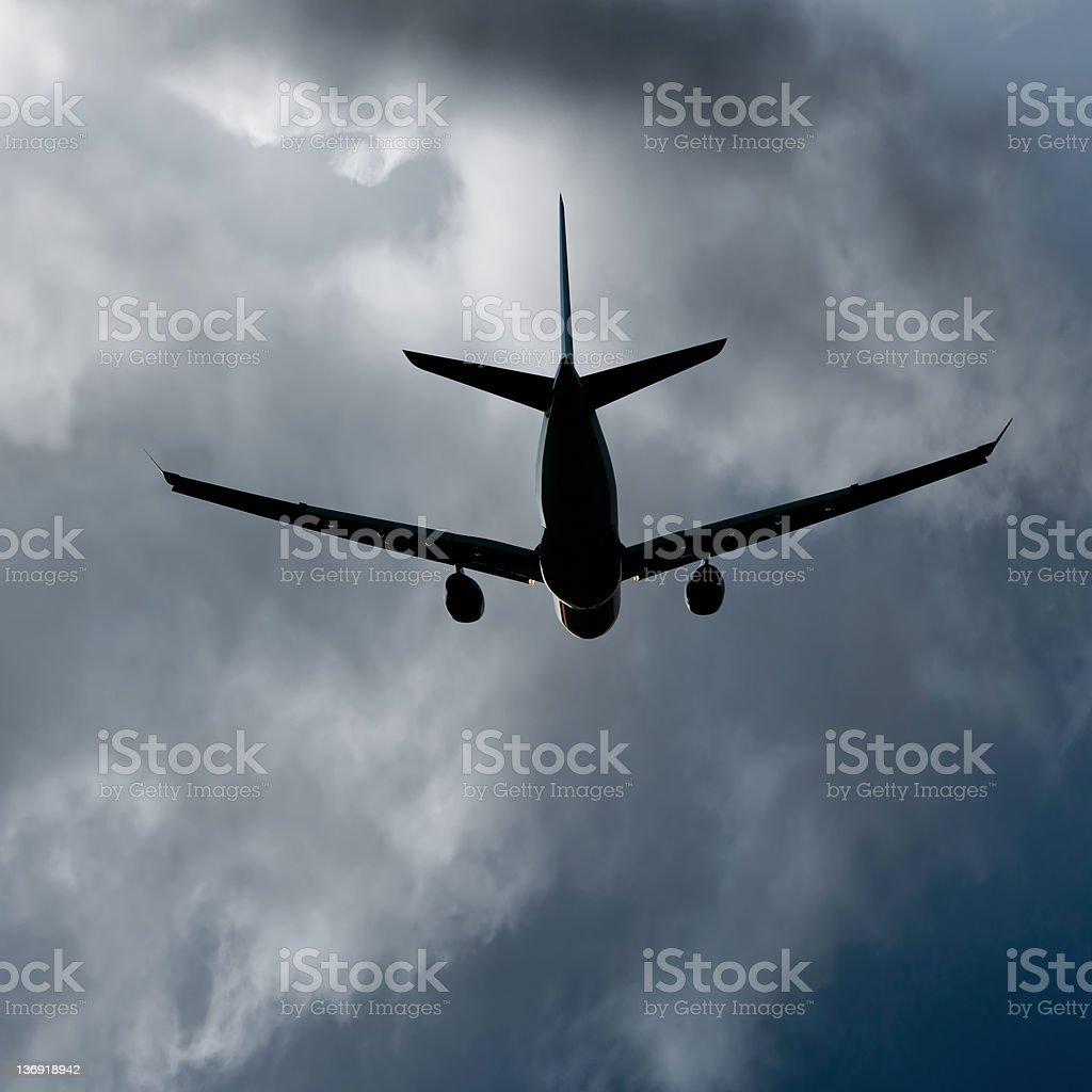 XL jet airplane taking off in storm royalty-free stock photo