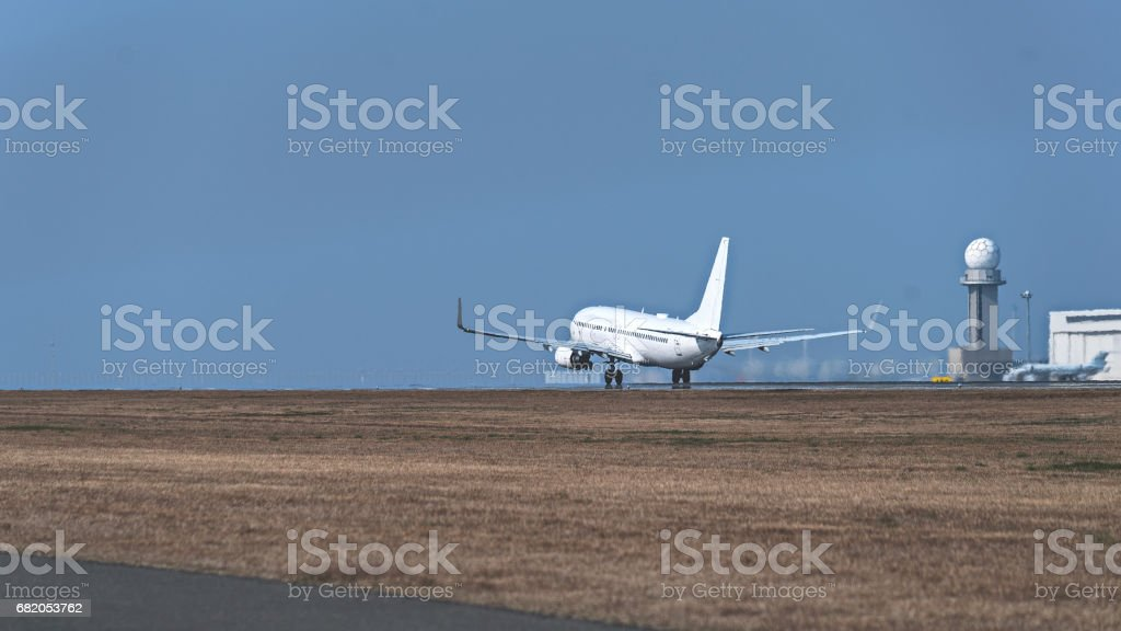 Jet airplane taking off the runway in an airport stock photo