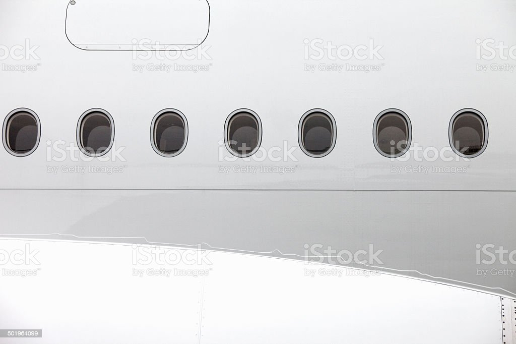 Jet airplane windows from outside, white fuselage stock photo