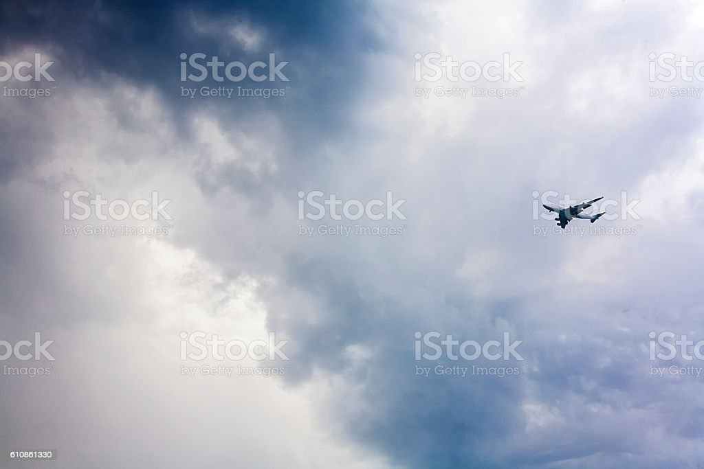 Jet approaching against a stormy sky stock photo