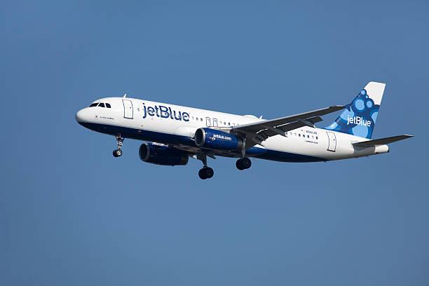 Jet Blue Airbus over Boston stock photo