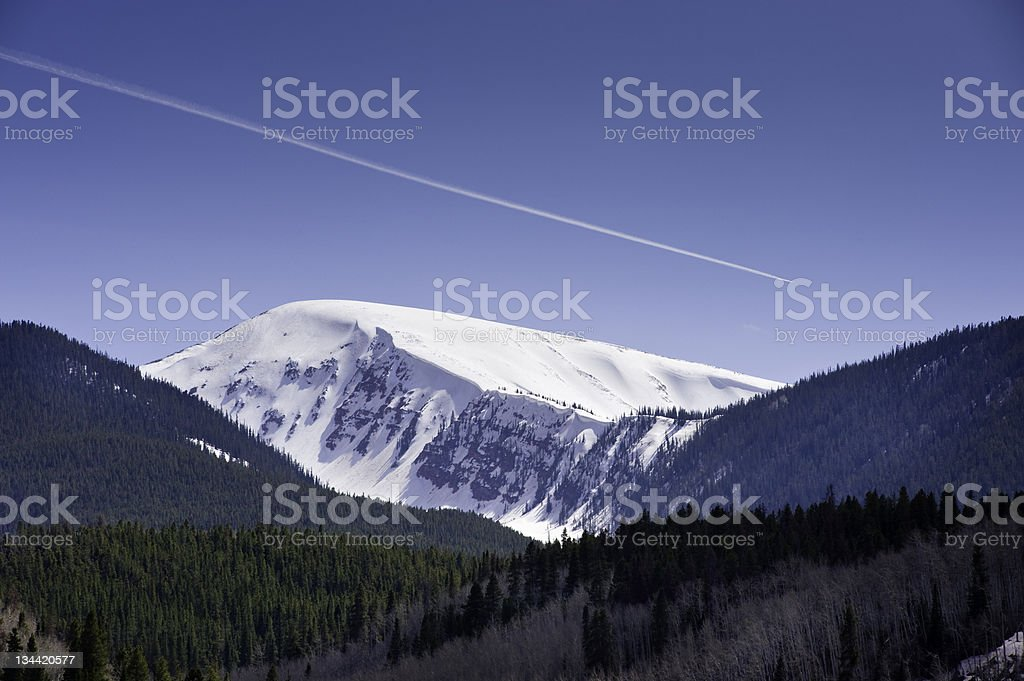 Jet Contrail in Blue Sky Over Scenic Mountain royalty-free stock photo