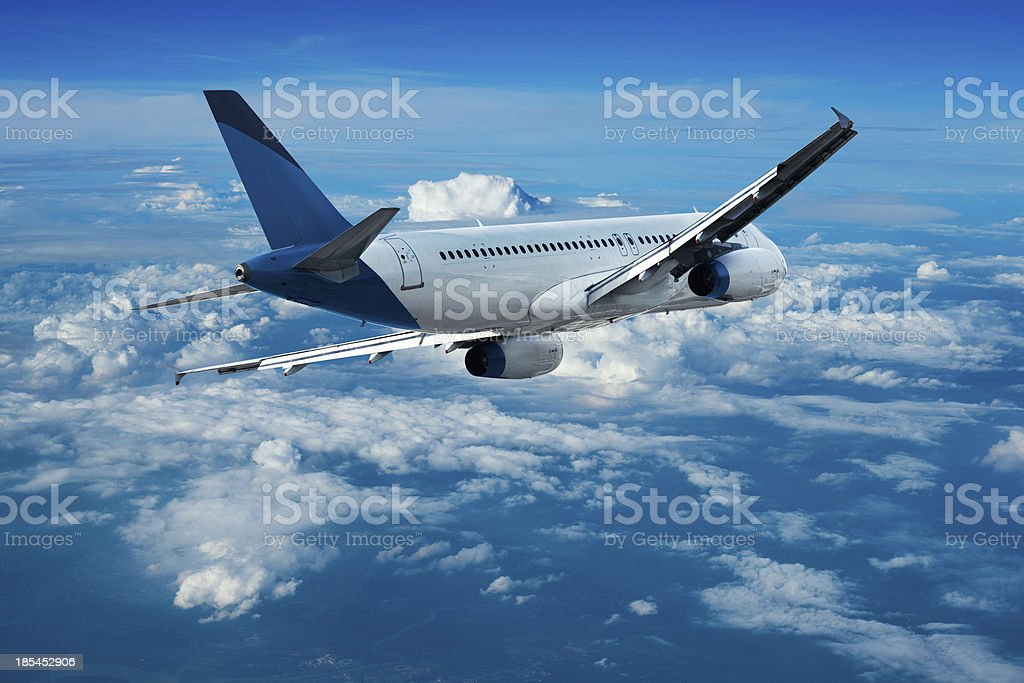 Jet cruising above the clouds royalty-free stock photo