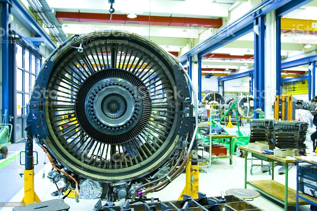Jet Engine in Maintenance Hangar. Full overhaul of Jet Turbine stock photo