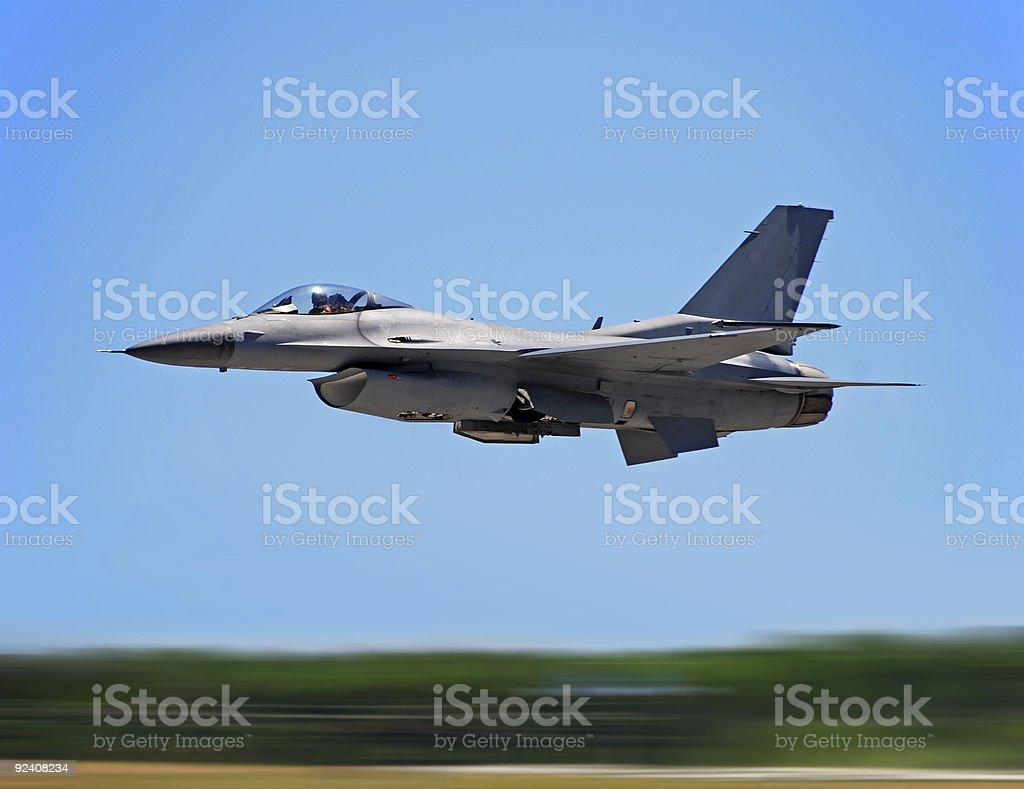 Jet fighter on high speed pass stock photo
