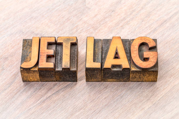 jet lag word abstract in wood type jet lag - word abstract in vintage letterpress wood type printing blocks jet lag stock pictures, royalty-free photos & images
