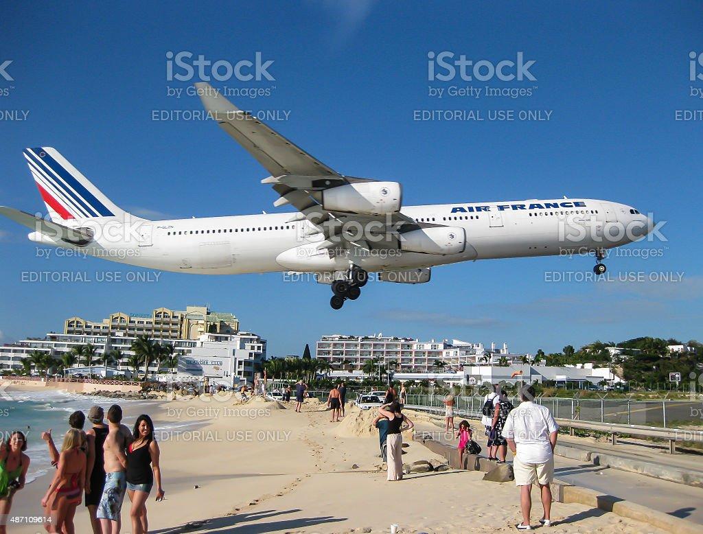 Jet Over Maho Beach stock photo