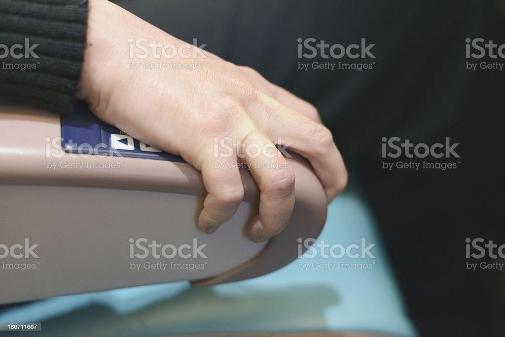 Jet Passenger Grips Armrest from Fear royalty-free stock photo