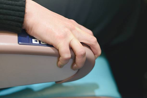 Jet Passenger Grips Armrest from Fear stock photo
