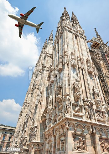 istock Jet plane flying low over the Milan Cathedral 510568658