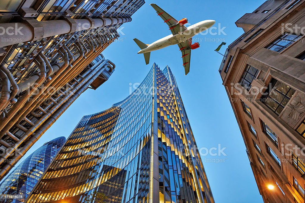 Jet plane flying over the city stock photo