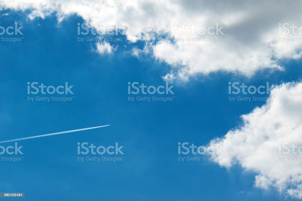 Jet plane high in the blue sky royalty-free stock photo