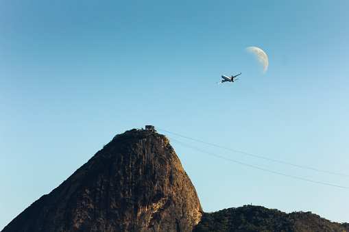 Jet Plane Taking off Against Sugar Loaf and Waning Moon