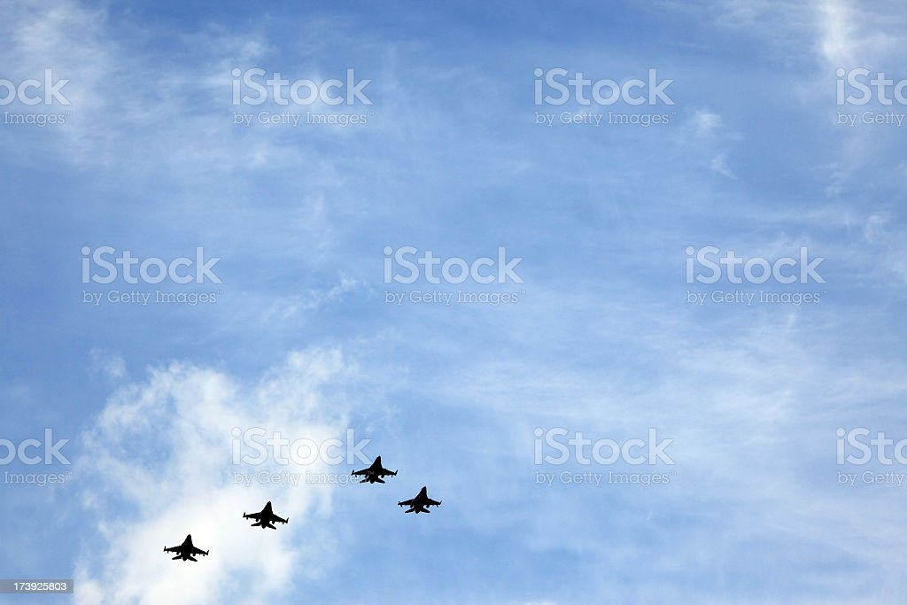 Jet planes flying in group in the sky royalty-free stock photo