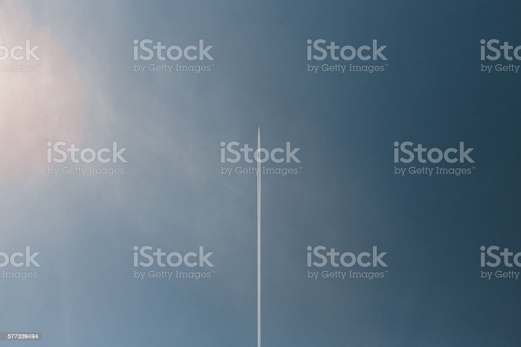 jet prints in blue sky stock photo