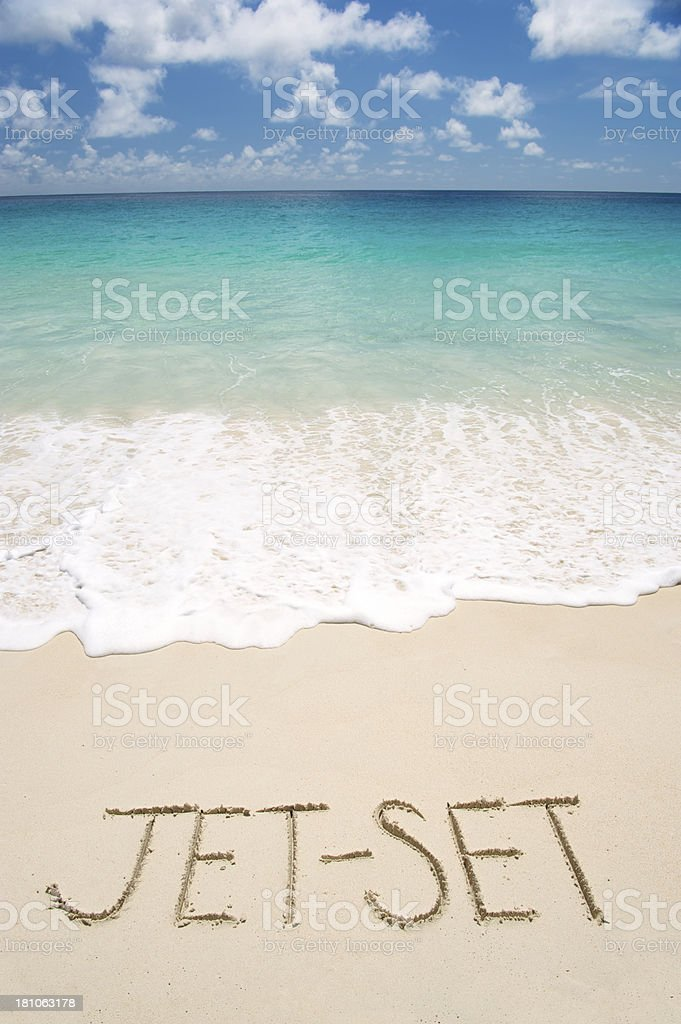 Jet Set Message in Clear Sand on Bright Tropical Beach royalty-free stock photo