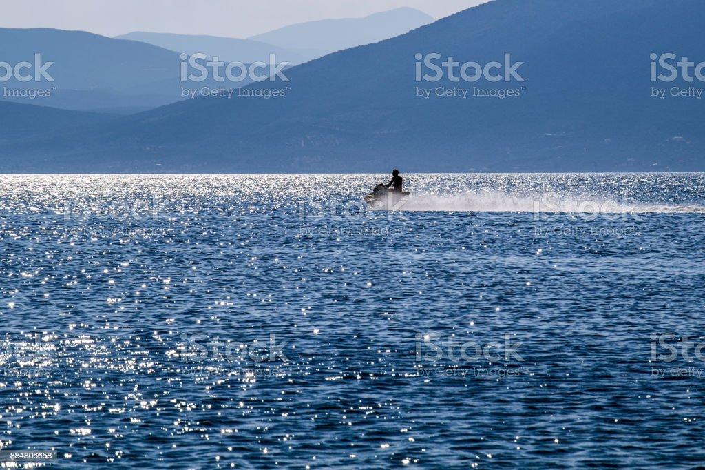 Jet ski in the distance stock photo