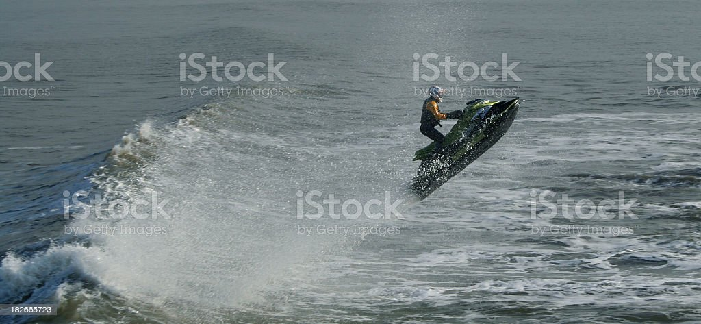 Jet Ski Jumping the Waves stock photo