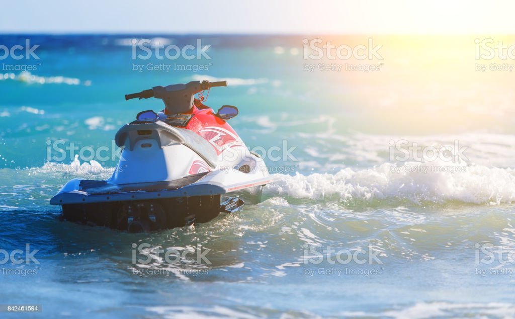 Jet Ski Moored inon on waves of sea stock photo