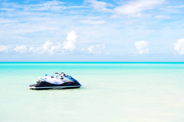 Jet ski on turquoise sea water in Antigua. Water transport, sport, activity. Speed, extreme, adrenaline. Summer vacation on caribbean. Wanderlust, travel, trip. Adventure, discovery, journey stock photo