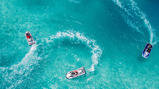 Aerial view of Jet Ski, Tropical Ocean Maldives island summer vacation