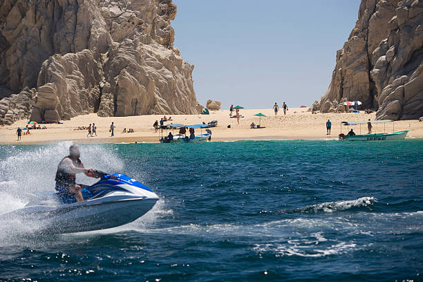 Jet skiing at Lovers Beach in Cabo, San Lucas stock photo