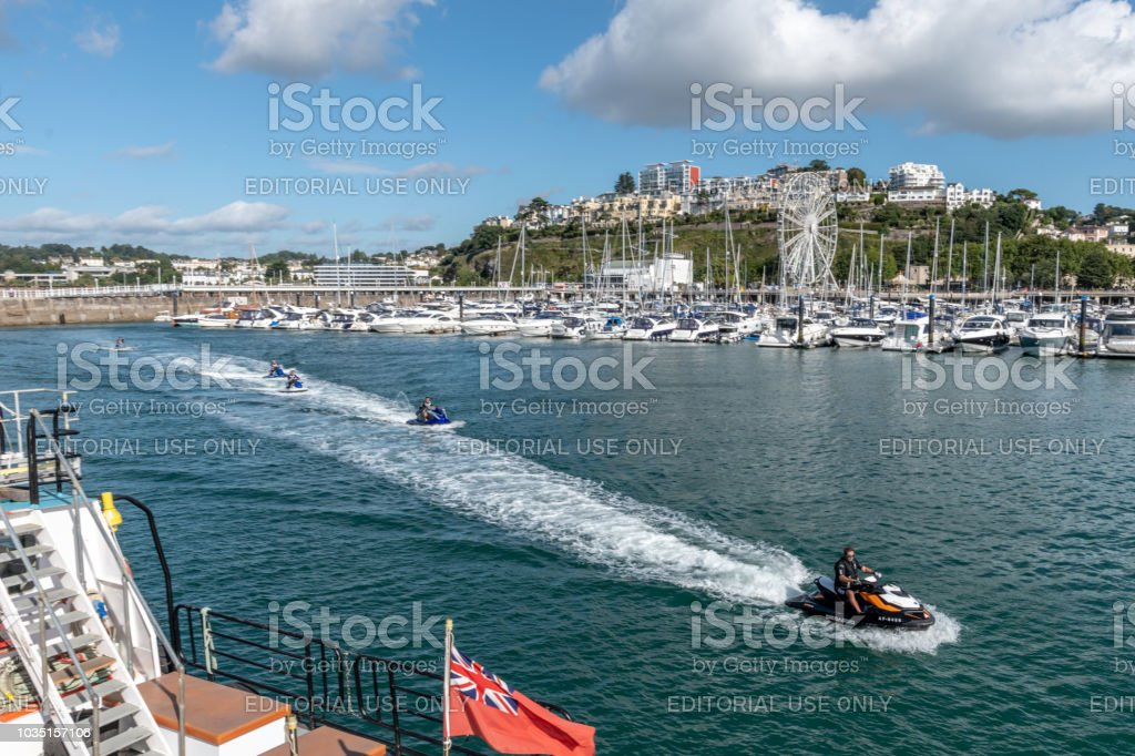 Jet skis in Torquay harbour stock photo