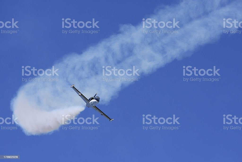 Jet stunt plane at an airshow with smoke trail. royalty-free stock photo