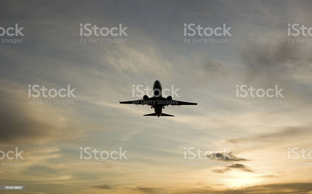 jet takeoff silhouette against sunset royalty-free stock photo