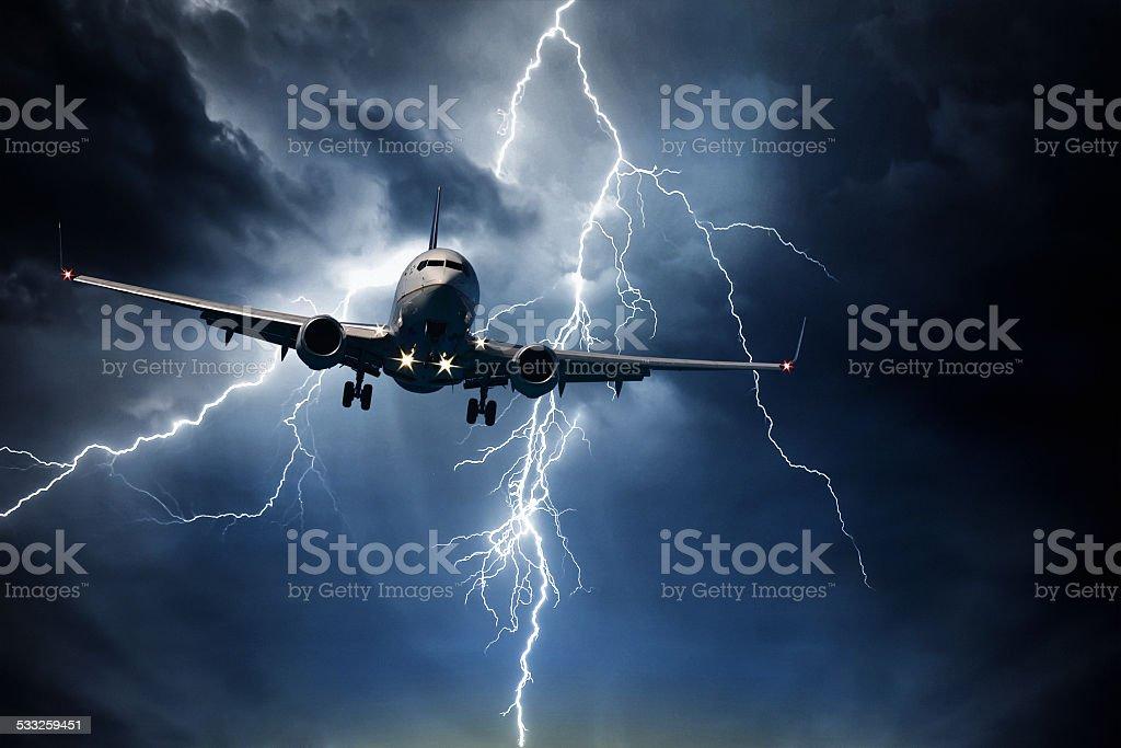 Jet travelling through stormy sky stock photo