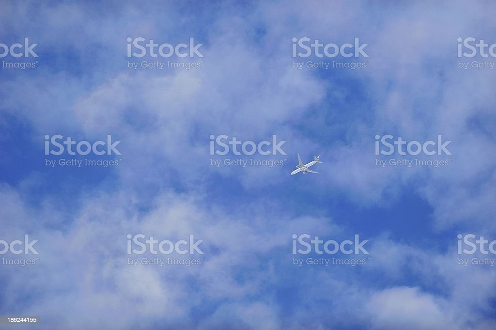 Jet under clouds royalty-free stock photo