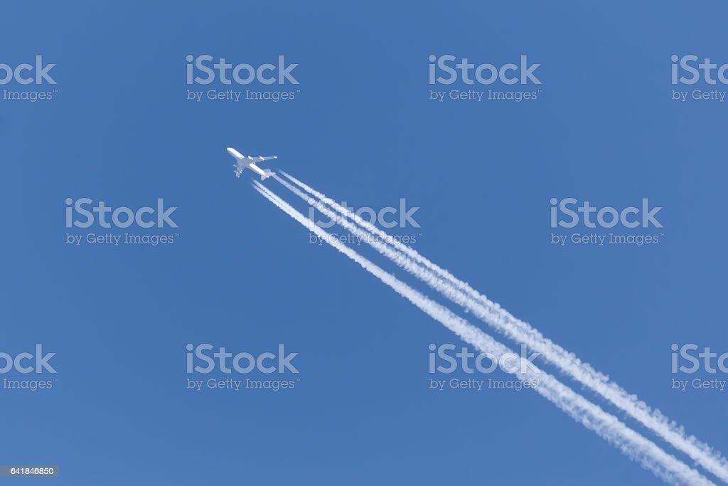 jet with four engines in the clear sky stock photo