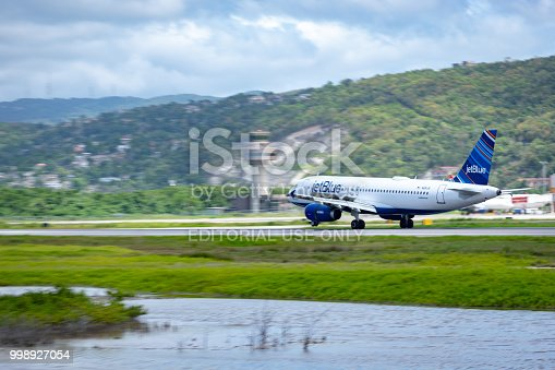 Montego Bay, Jamaica - April 11 2015: JetBlue aircraft on the runway at Sangster International Airport (MBJ) in Montego Bay, Jamaica.