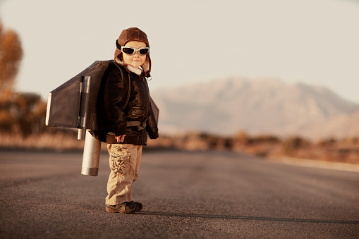A young boy can't wait to fly the sky with his rocket pack.