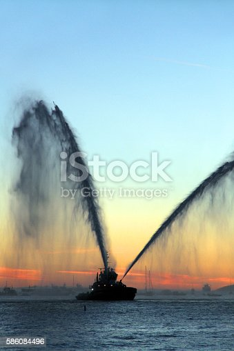 A firefighting tug boat demonstrates its abilities in Vancouver's English Bay.