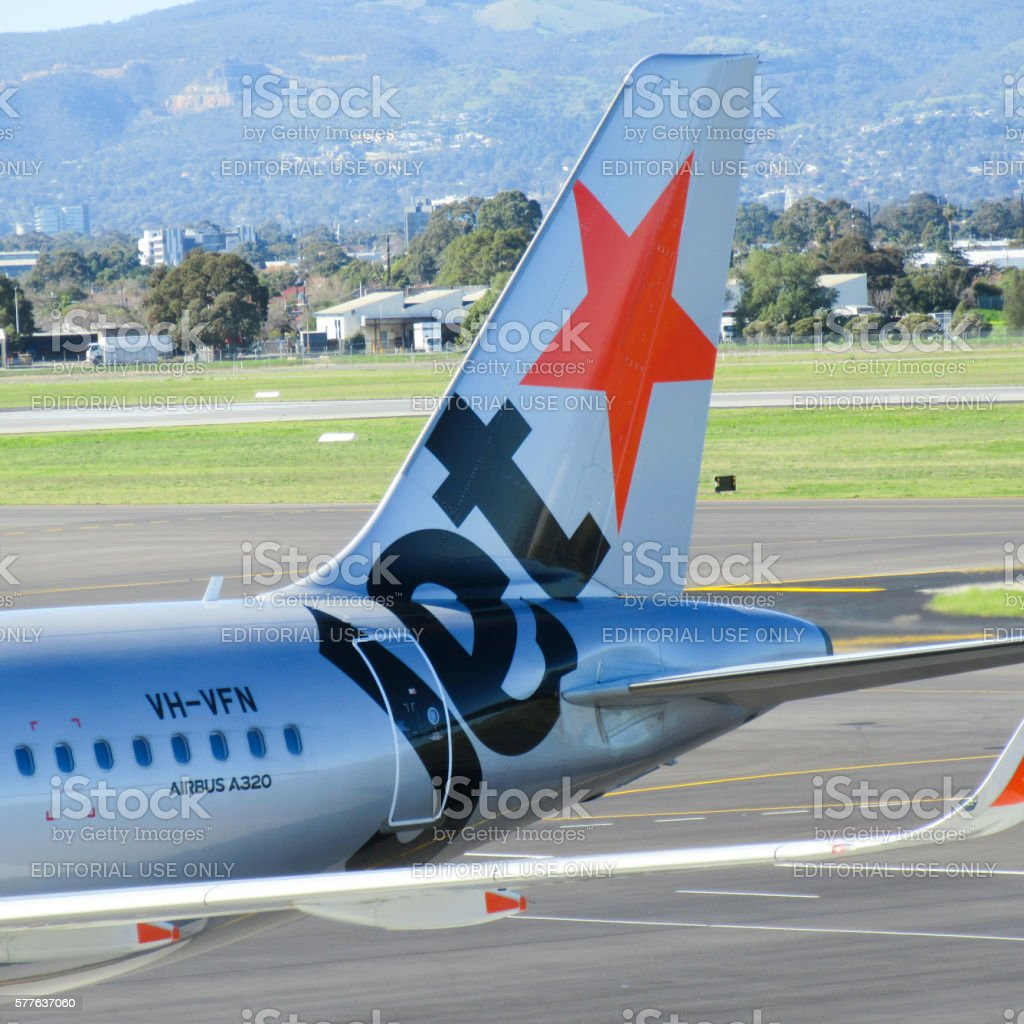 Jetstar Aircraft Tail stock photo