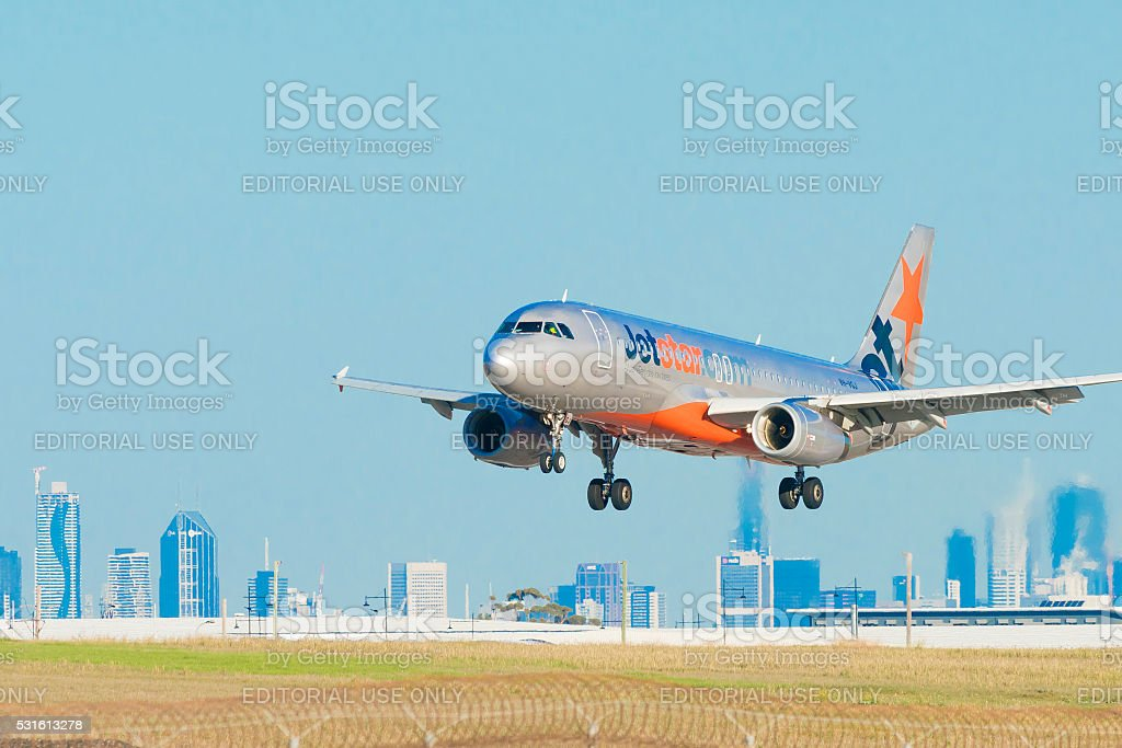 Jetstar airplane landing at Melbourne Airport stock photo