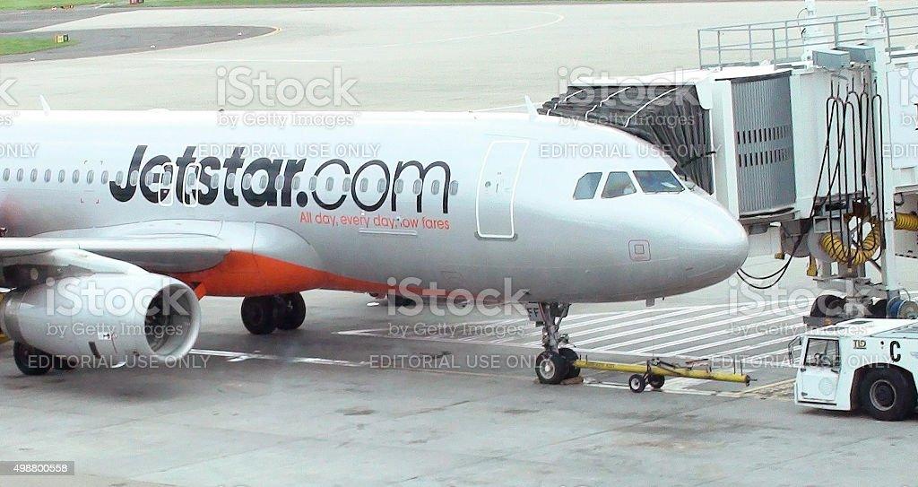 Jetstar Airplane Parked At Loading Gate Of Sydney Airport stock photo