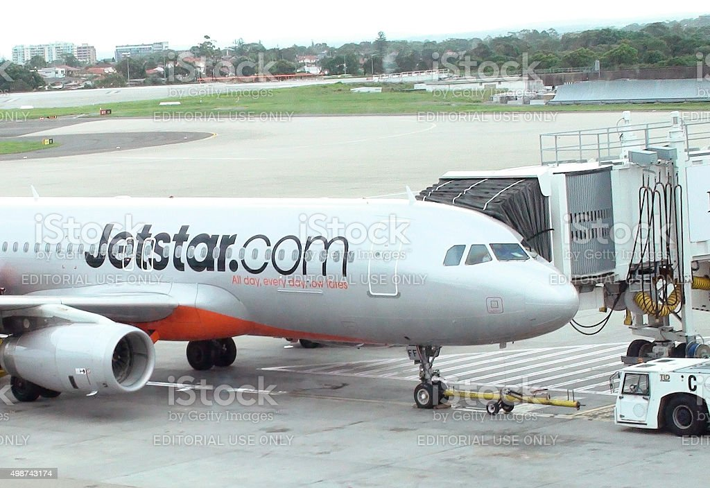 Jetstar Airways Airplane Parked At Loading Gate Of Sydney Airport.Australia stock photo