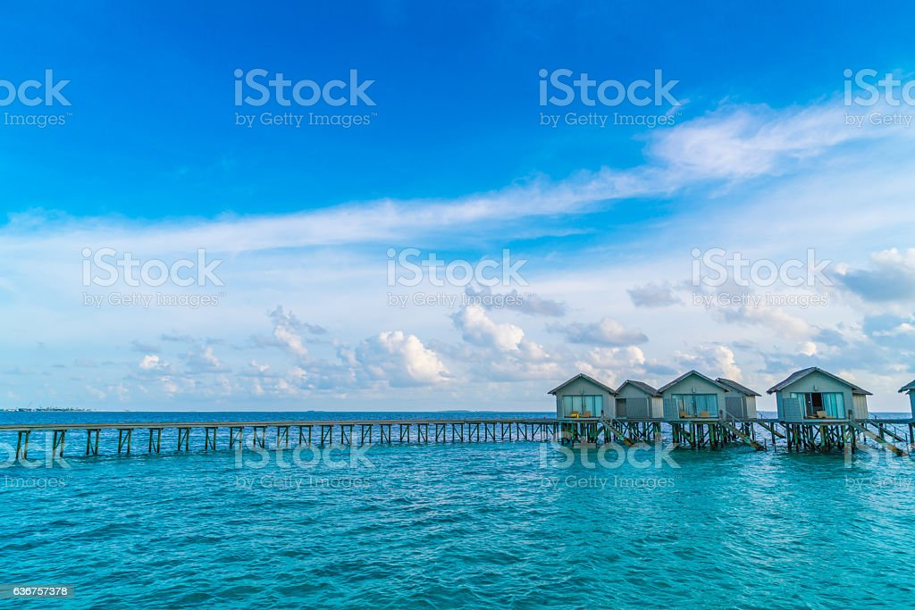 Jetty and bangalows in Maldives stock photo