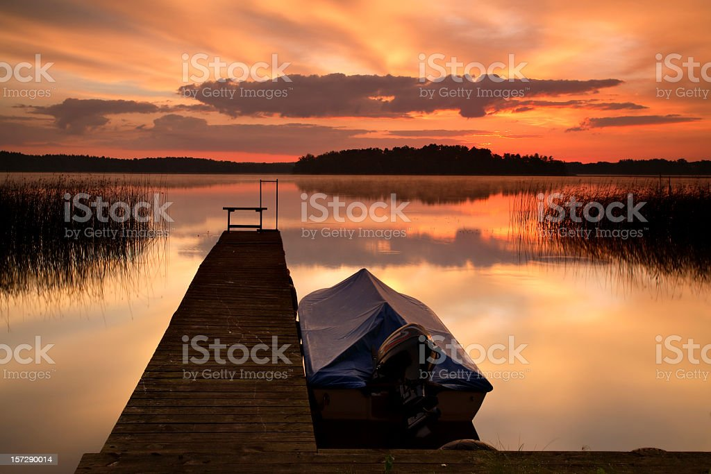 Jetty and Boat at Dawn royalty-free stock photo