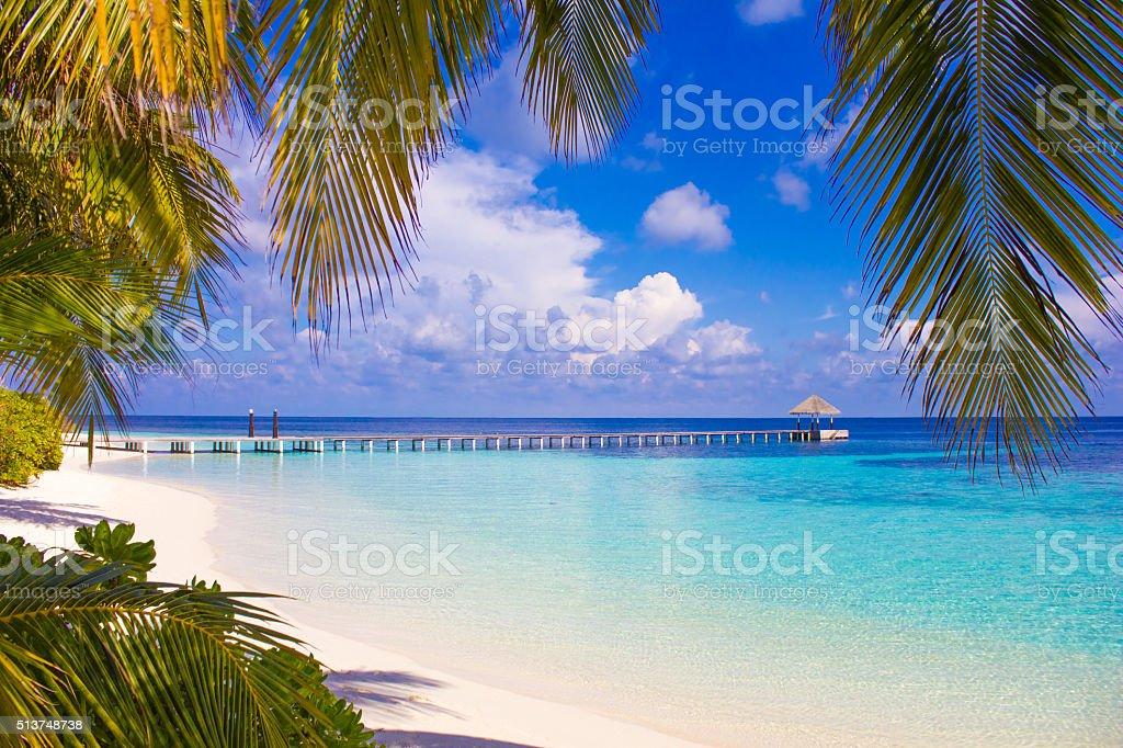 Jetty and lagoon in North Ari Atoll, the Maldives stock photo