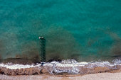 Aerial view of the jetty and sea. Taken via drone.