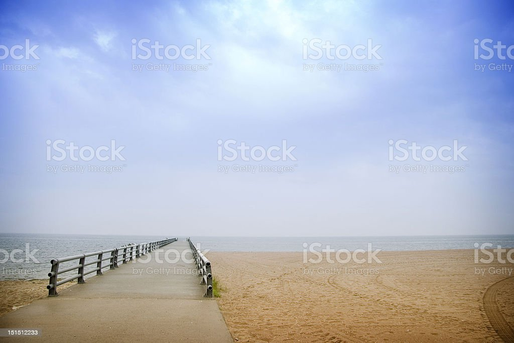 Jetty and the beach royalty-free stock photo